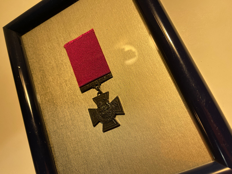 medal in picture frame