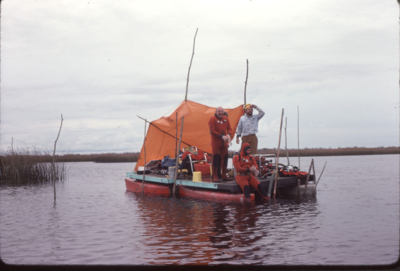 Barge Dick Wilson standing in diving suit, Rick Wilson standing, Don Rocan sitting