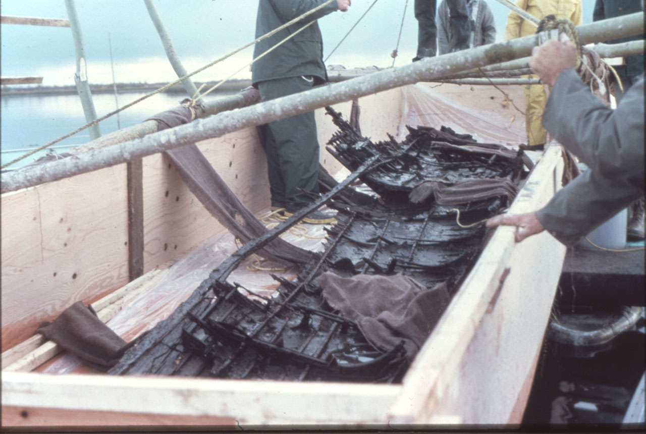 The hull remains in its box for transport