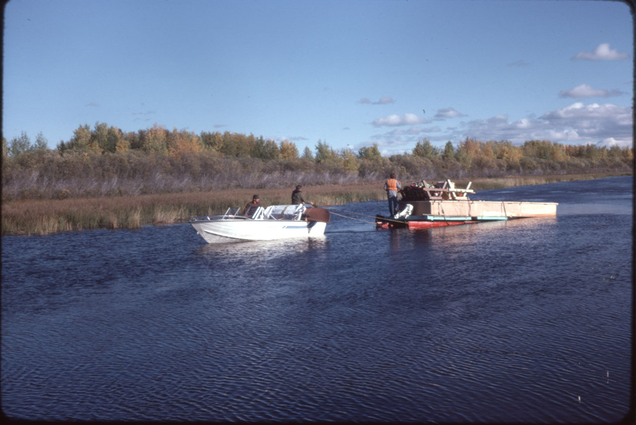 Help from the American fishermen to move the barge with its load back to Cormorant